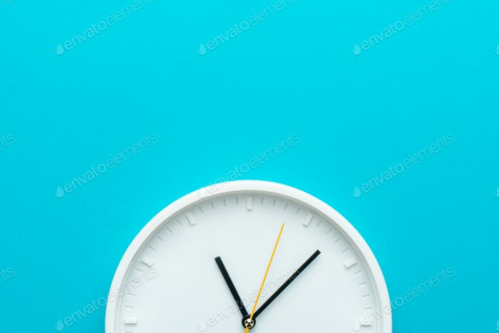 Photo of Part of White Wall Clock Over Turquiose Blue Background With Copy Space