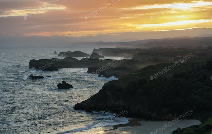Sunrise panorama from Guadamia beach viewpoint, Asturias