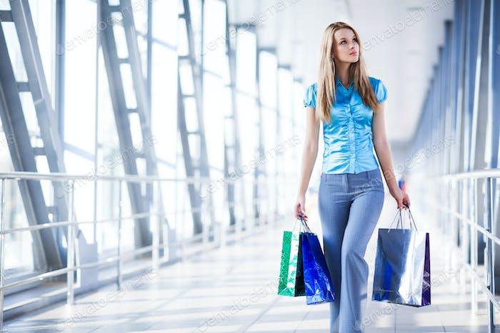 Beautiful women posing standing in shopping mall