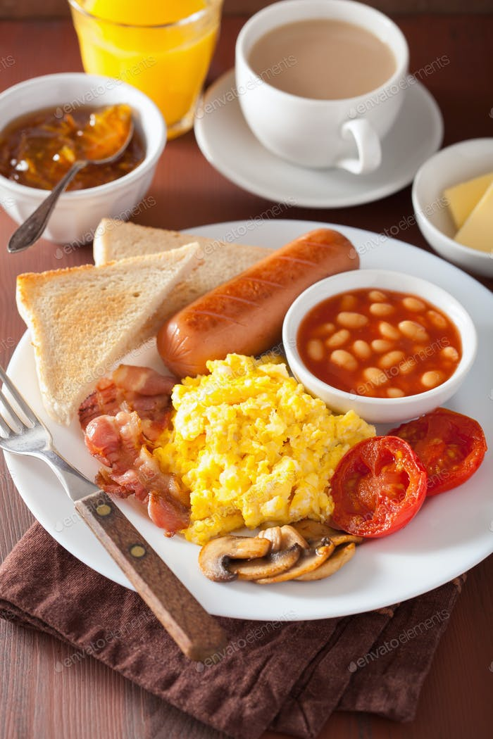 full english breakfast with scrambled eggs, bacon, sausage, bean