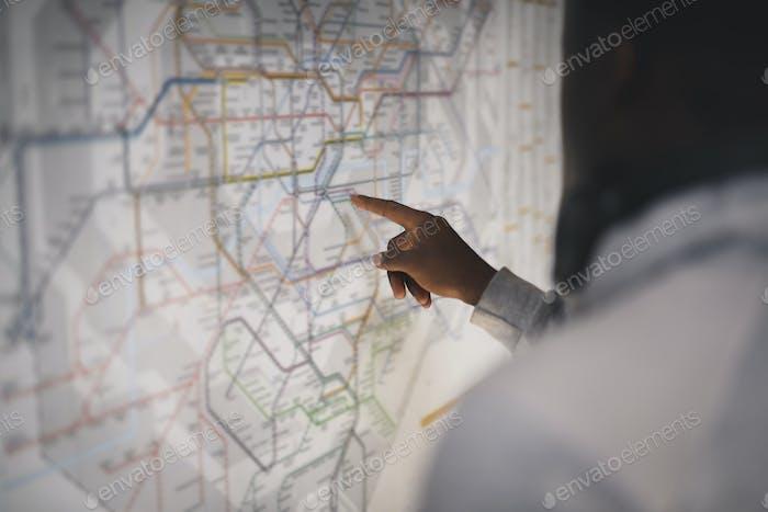 Couple checking a public transportation map