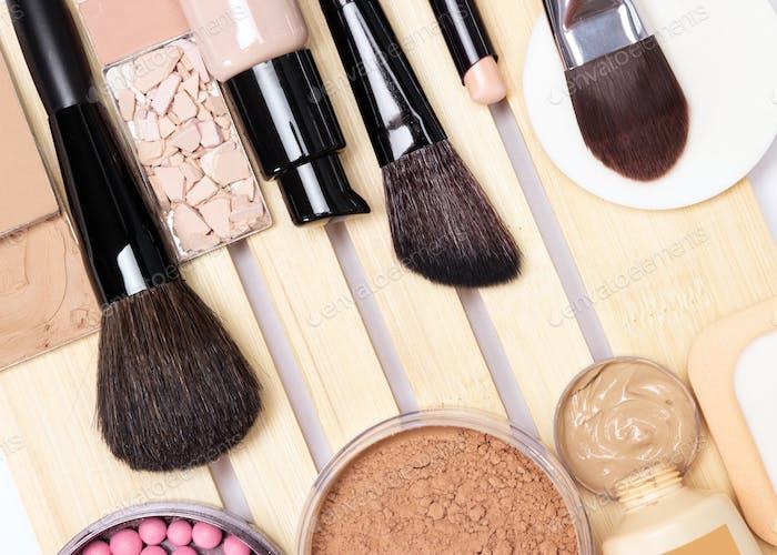 Concealer, primer, foundation, powder, blush with make-up brushe