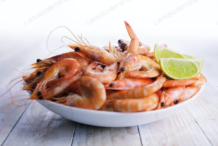 Big boiled shrimps in white plate