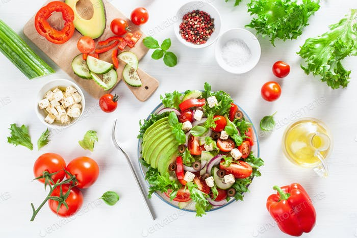 greek style avocado tomato salad with feta cheese, olives, cucum