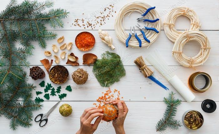 Creative diy hobby. Handmade craft christmas decoration, balls and garland