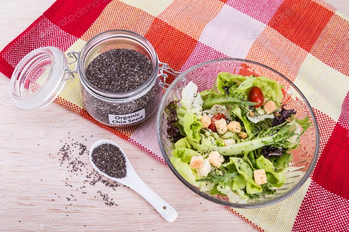 Organic chia seeds with salad healthy meal loaded with antioxida