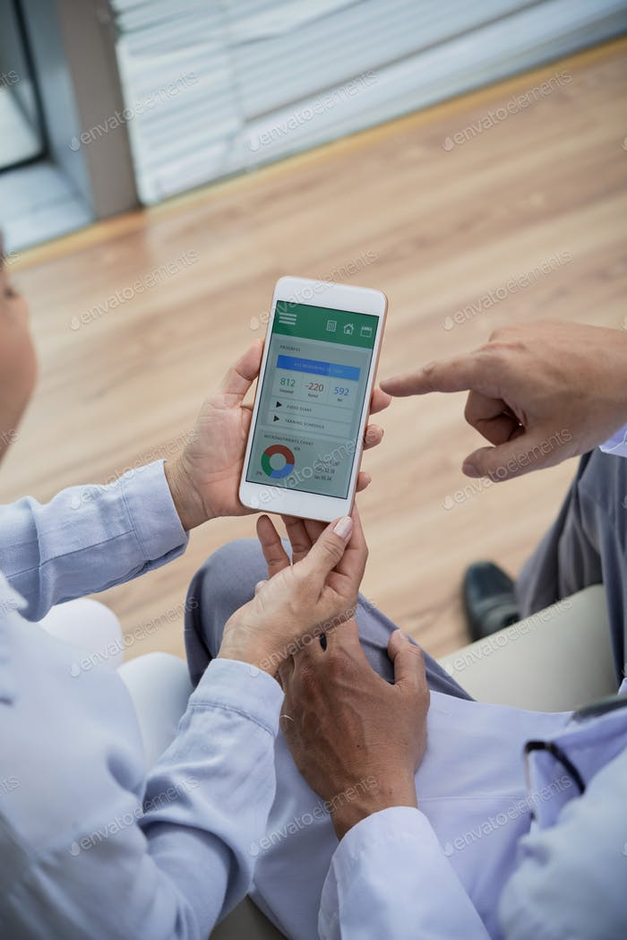 Senior Patient Using Health Monitoring App