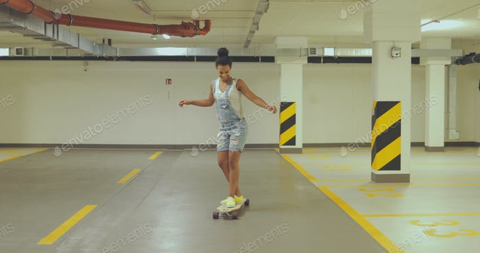 Girl skateboarding on parking