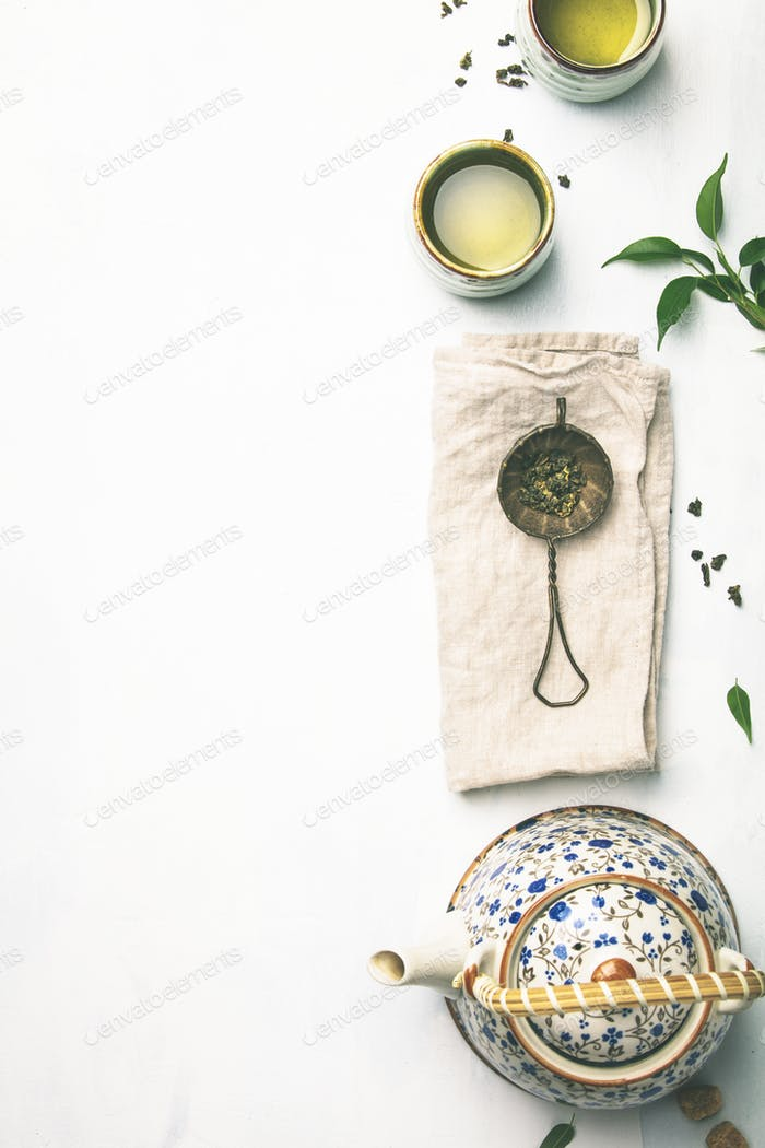 Tea composition on grey background, flat lay