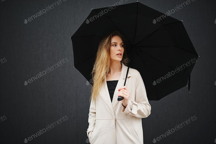 beautiful blonde girl with umbrella