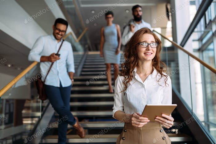Portrait of young businesswoman in hall of company