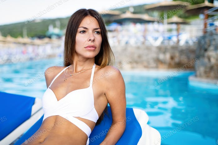 Pretty sexy slim girl at tropical sea beach