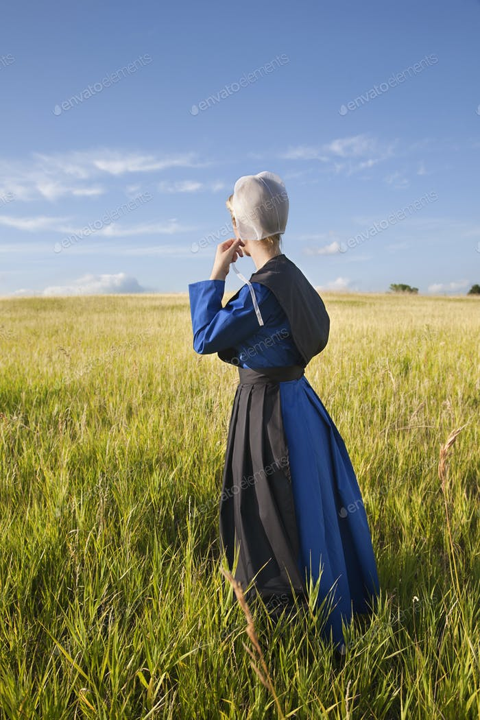 Old Order Amish Woman Standing in a Field