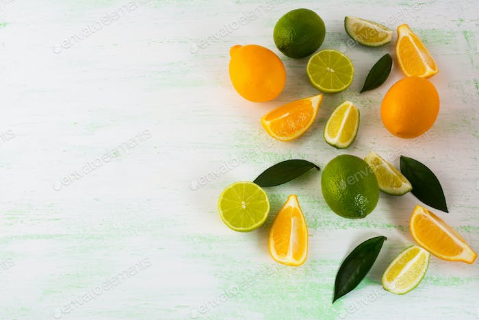 Citrus fruits mix on light green background