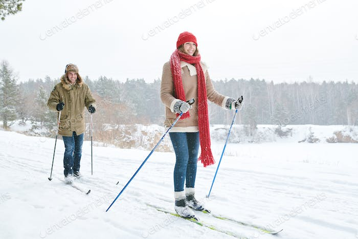 Couple Skiing in Forest