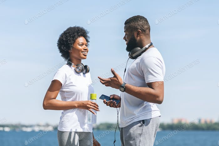 Afro Couple Chatting Before Morning Run Along River Embankment