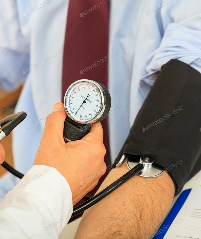 Doctor measuring blood pressure, closeup vertical view