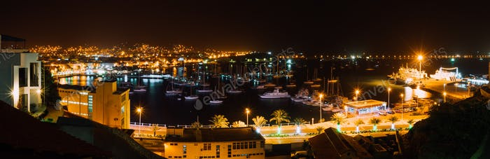 Panoramic night picture of Mindelo city in twilight. Port town with many boats in the lagoon on the