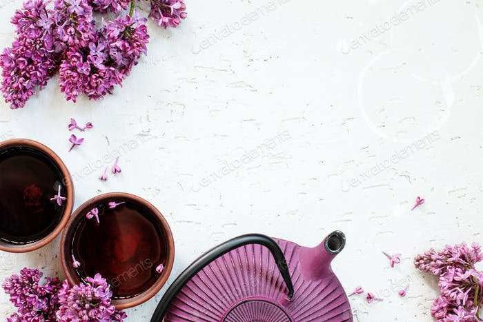Background with Teapot, Two Cups of Tea and Lilac