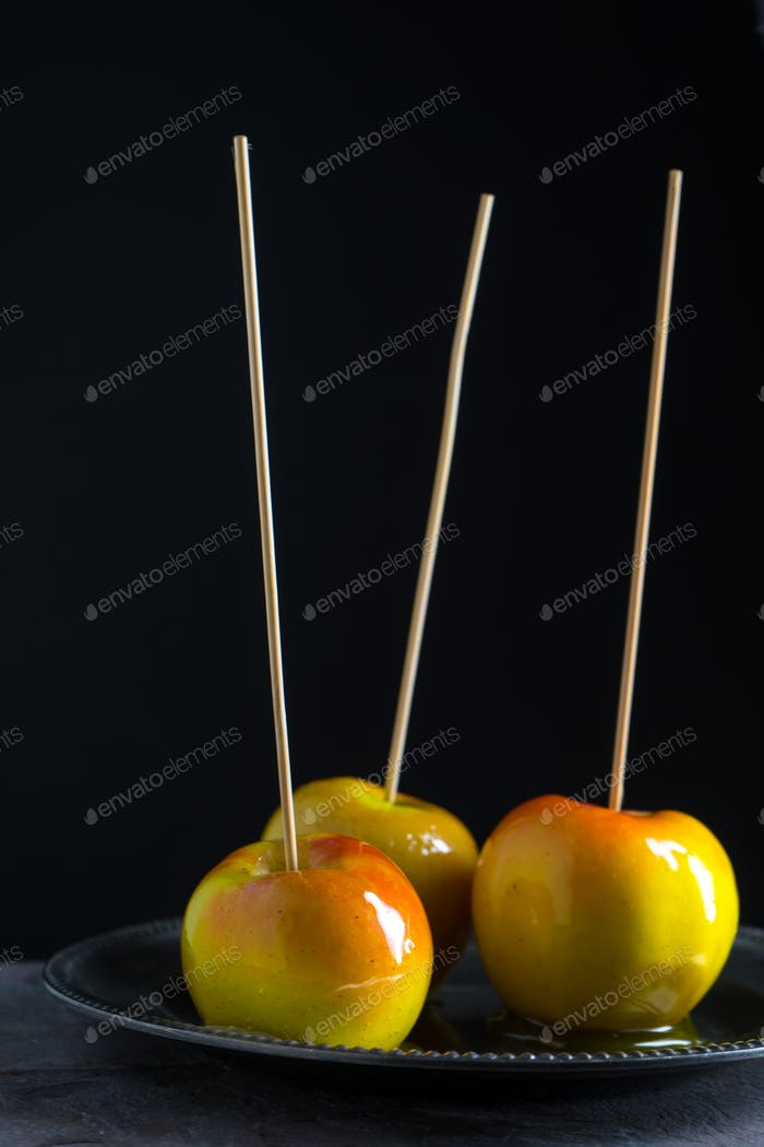 Caramel apples for Thanksgiving on a black background