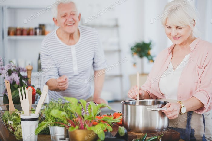 Senior woman preparing a meal