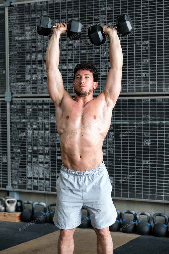 Bodybuilder exercising with dumbbells