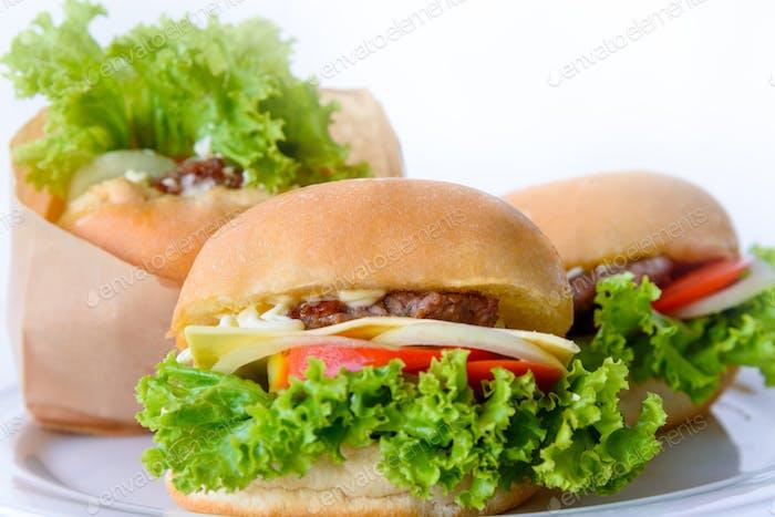 Group of three hamburger on a white background