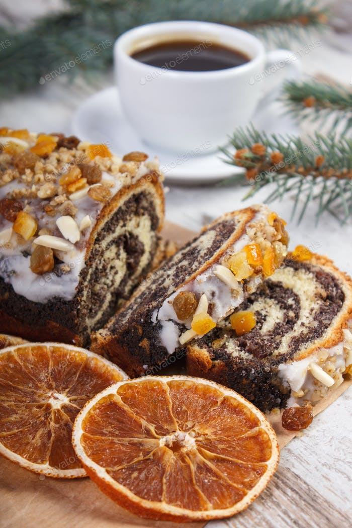 Poppy seeds cake, cup of coffee and spruce branches, dessert for Christmas time