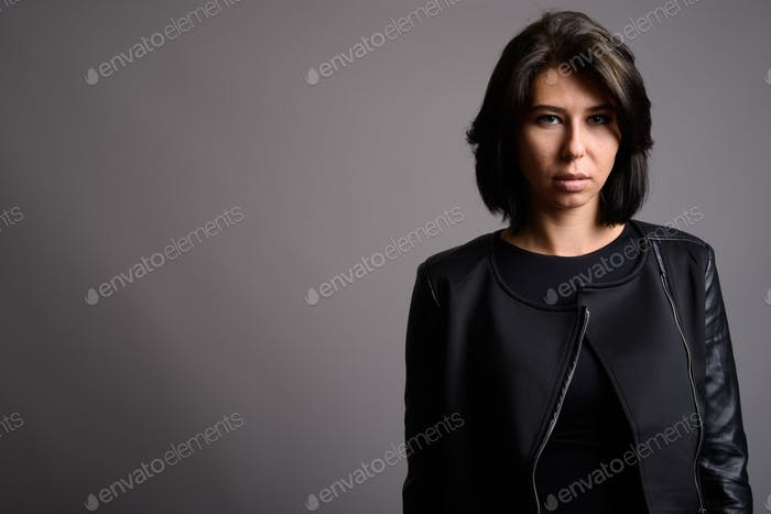 Young beautiful woman against gray background