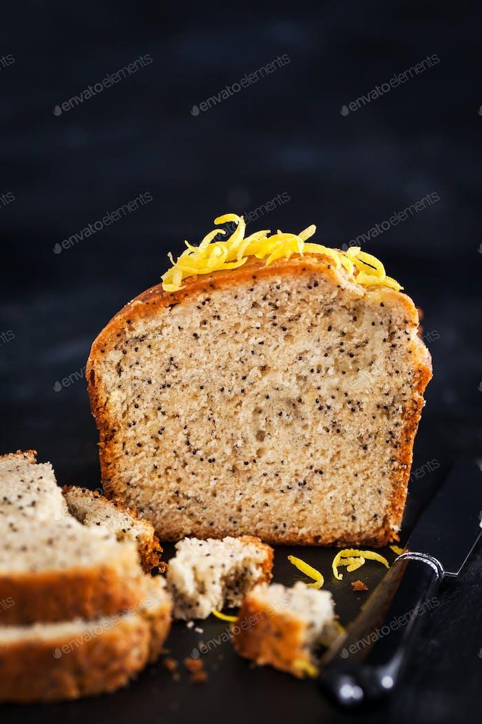 Lemon and poopy seeds pound cake on dark background