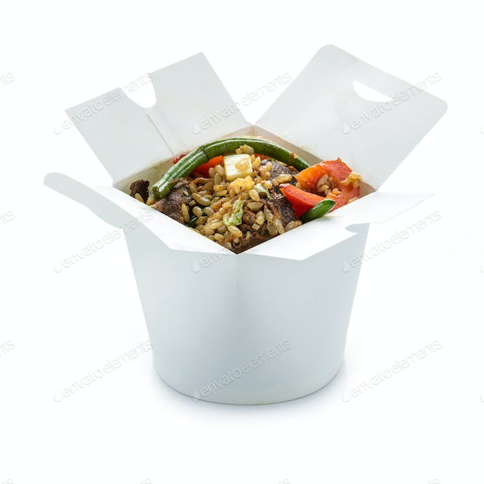 Wok rice with duck and vegetables in take-out box over white. Wi