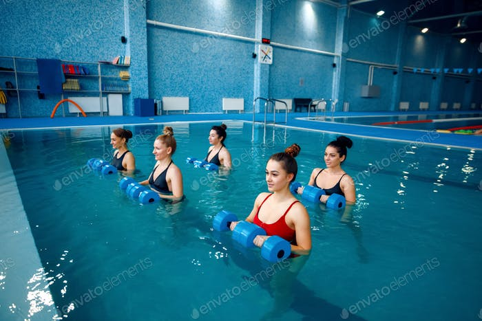 Female swimmers group, aqua aerobics in the pool