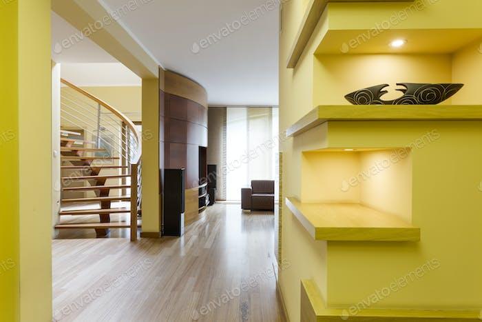 Vivid hall with lemon walls