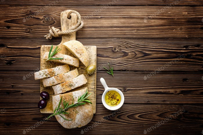 Delicious homemade italian ciabatta bread with olive oil and olives