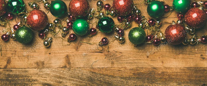 Colorful christmas tree decoration balls on wooden background, copy space