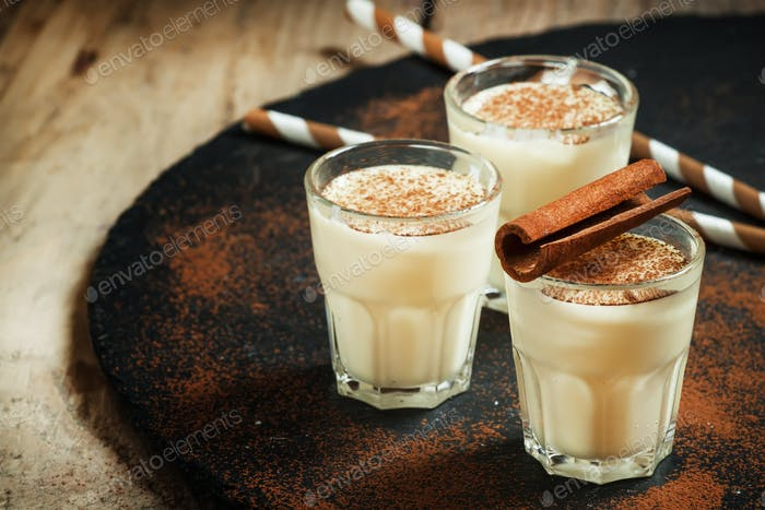 Traditional winter eggnog  with milk, rum and cinnamon