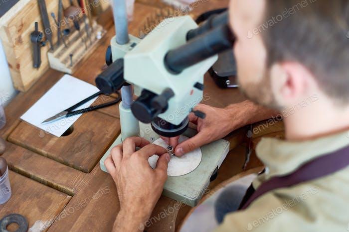 Jeweler Inspecting Precious Stone