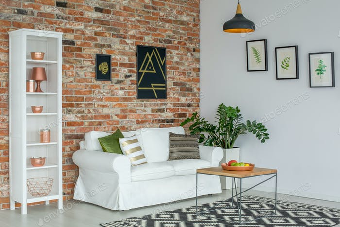 Industrial living room with couch