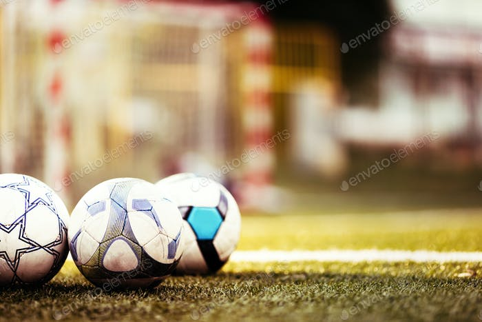 Soccer balls on football pitch