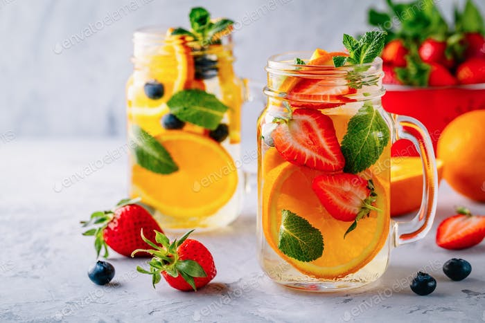 Infused detox water with orange, strawberry, blueberry and mint.