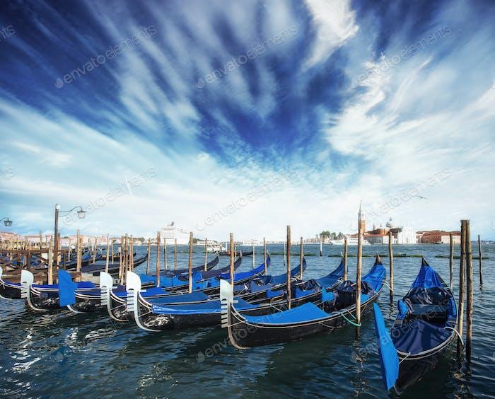 Gondolas on Grand canal in Venice, San Giorgio Maggiore church. San Marco. Beautiful summer