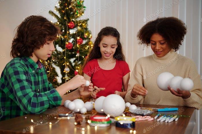 Friends creating styrofoam snowmen