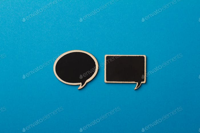 square and round charcoal speech bubbles on blue