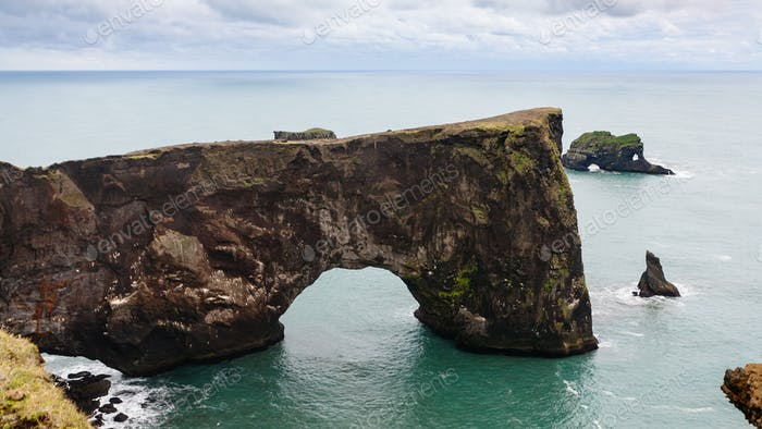 view stone arch on Dyrholaey peninsula in Iceland