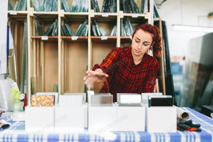 Woman worker packing products for shipment.