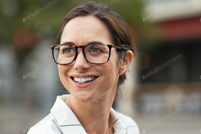 Smiling business woman with spectacles