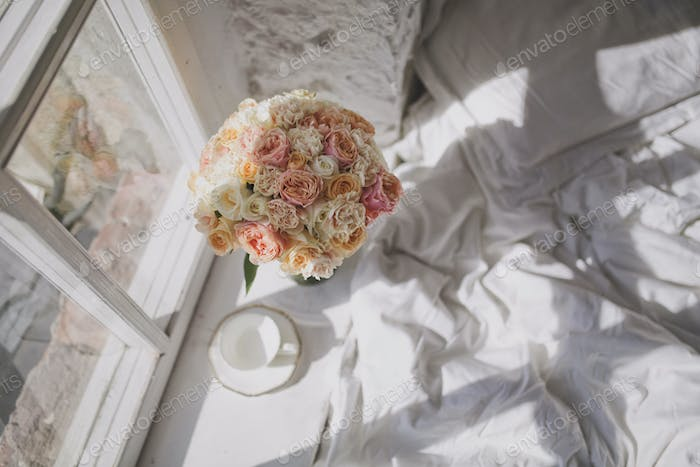 A charming bouquet of roses on the windowsill