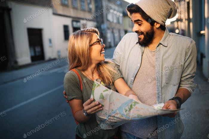 Traveling couple of tourists walking around old town. Vacation, summer, holiday, tourism concept