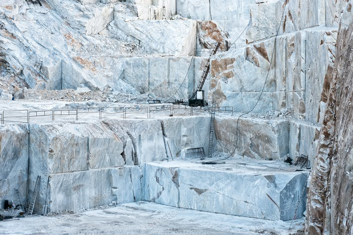 Open cast mine pit with white Carrara marble