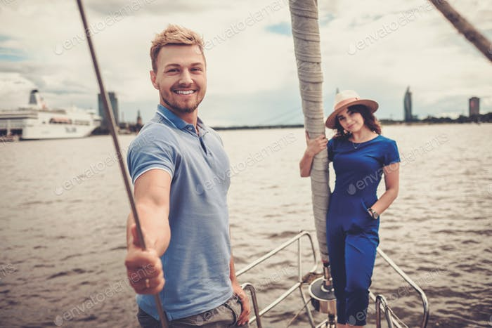 Happy couple resting on a yacht